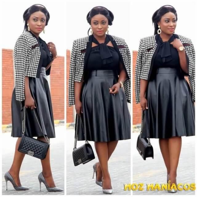 Vestido preto e casaco preto e branco