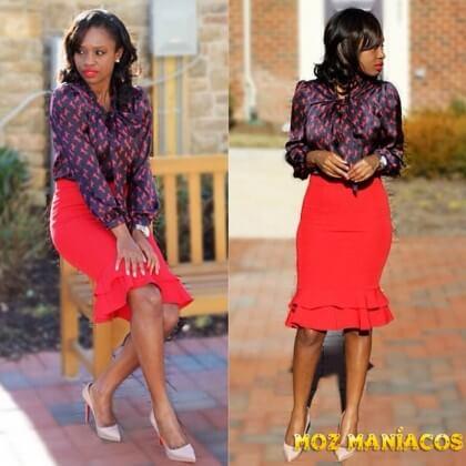 Blusa preta com partes avermelhadas e saia vermelha