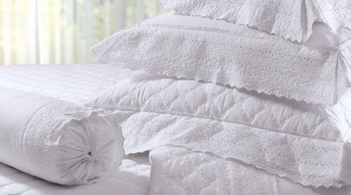 Almofadas, fronhas e lençóis